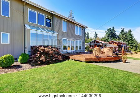 Great Curb Appeal Of Luxury House With Back Deck