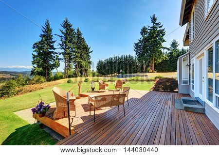 Large Walkout Deck With Wicker Furniture