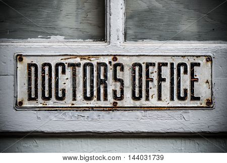 A Doctor's Office Sign On A Rustic Wooden Door