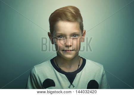 Portrait of happy joyful beautiful happy teenage boy with stylish haircut and bright eyes softbox lighting studio shot.