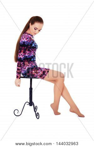 model with very long hair on a chair