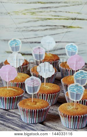 Yummy Homemade cupcakes on the wooden background