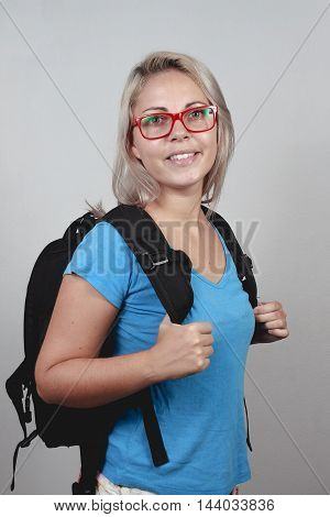 Young Blonde Schoolgirl With Red Glasses And School Bag