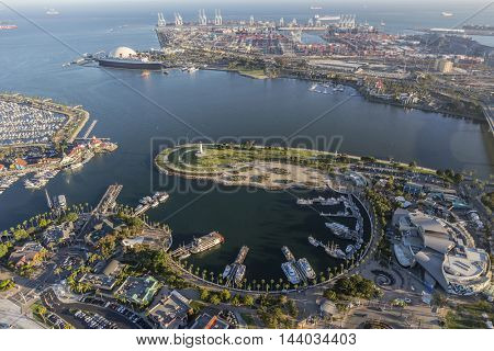 Long Beach, California, USA - August 16, 2016:  Afternoon aerial view of Rainbow Harbor, tour ships, aquarium and Queen Mary attractions.