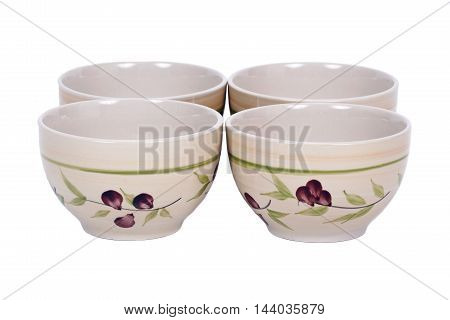Four painted bowls separated on white background