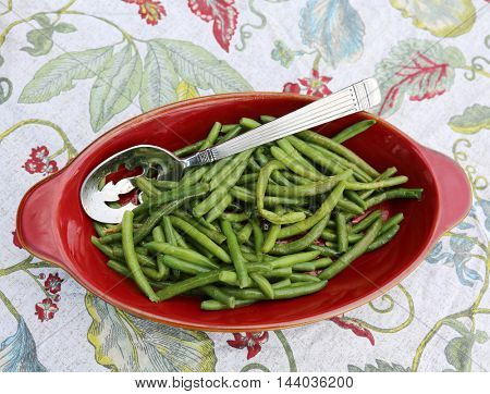 Red Dish with a Silver Serving Spoon of Fresh Steamed Green Beans