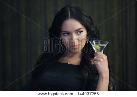 Glamorous and sexy brunette with a glass of Martini