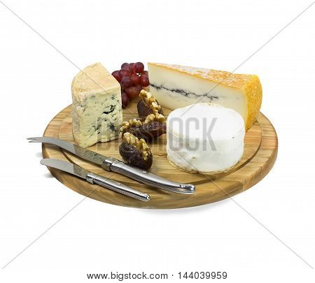 Closeup of cheese board with three different type of french cheeses on white background