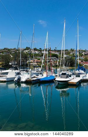 Yachts Moored At Marina At Beautiful Sunny Day
