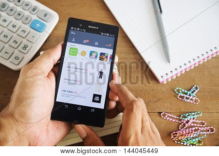 PHUKETTHAILAND Aug 20 2016 : Line icons on split screen mobile Line is largest and most popular social networking site in the world