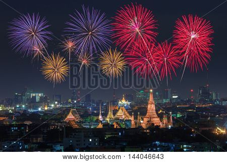 Wat Arun and Bangkok City with Colorful Fireworks Thailand