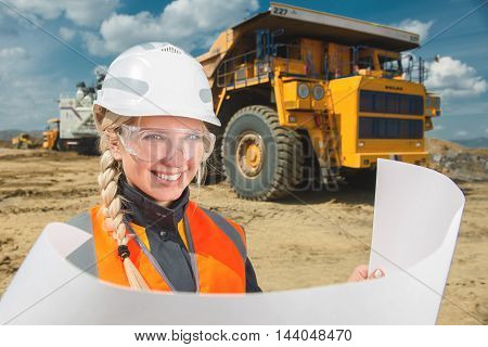 young beautiful female worker at an open pit