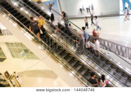 Blur People In Escalators At The  Shopping Mall