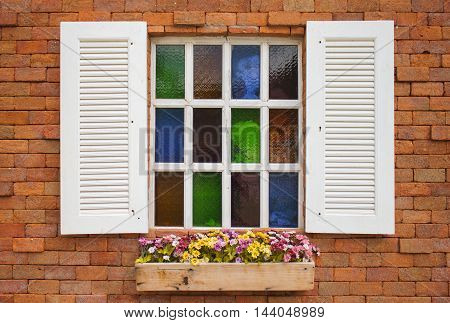 Typical Italian Window With Open Wooden Shutters Decorated With Fresh Flowers