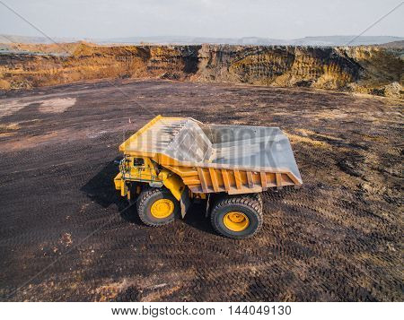 Big yellow mining truck at a quarry