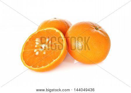 whole and half cut orange on white background