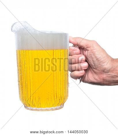 Closeup of a man's hand holding a pitcher of beer, isolated on white.