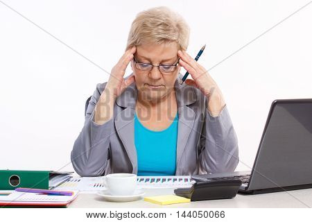 Elderly Business Woman Analyzing Financial Charts At Desk In Office, Business Concept