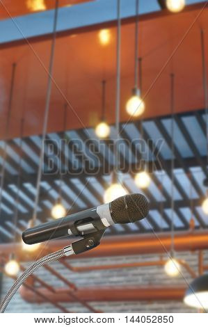 microphone in hall with lights in background. with extremely shallow dof