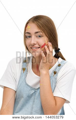 Girl smeared face paint. Creativity and Drawing