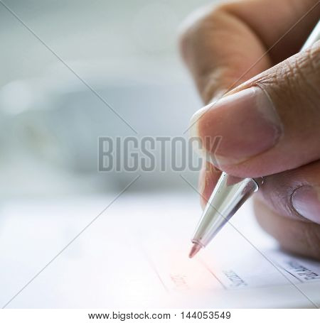 hand with pen over checklist form, Tickbox