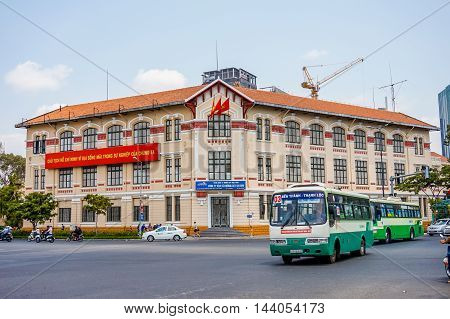 HO CHI MINH CITY, VIET NAM - MARCH 13, 2016: The beautiful building and transportation in Sai Gon.