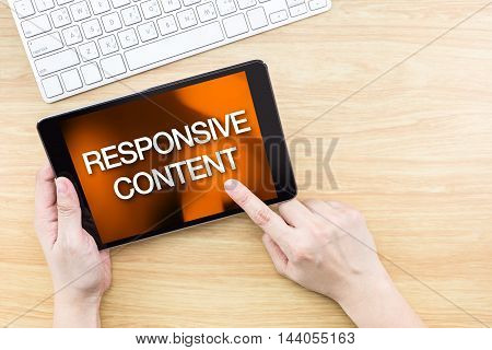 Finger Click Screen With Responsive Content Word With Keyboard On Wooden Table,website Design Concep