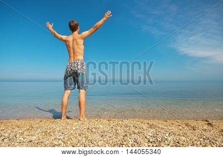 Man on the sea. Enjoyment scene.