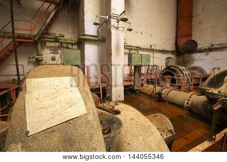 Old rusted pump station. Inside of industrial object.
