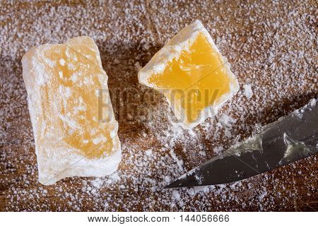 Close up of Turkish delight with powdered sugar and knife