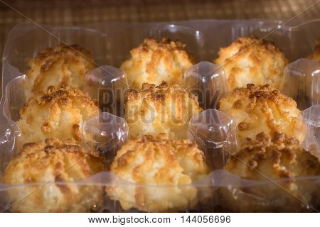 Coconut macaroons christmas cookies in plastic tray