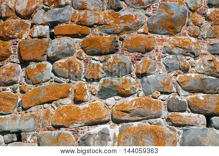 The texture of the old wall of the monastery tower. Architecture exterior background