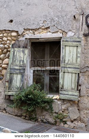 Obsolete window shutters in old city at France