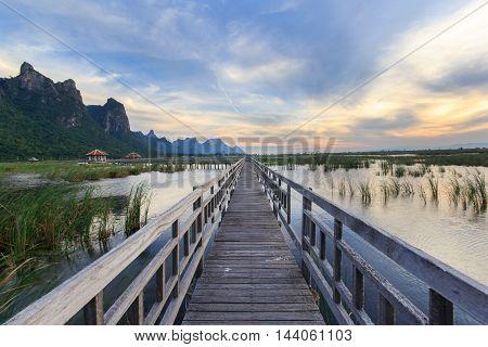 Wooden Bridge in lotus lake on sunset time at Khao Sam Roi Yot National Park Thailand