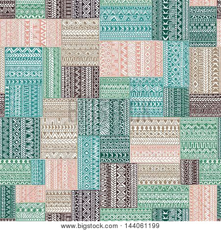Geometric pattern in patchwork style. Seamless complex pattern. Ethnic and tribal motifs. Square multicolored patches. Print drawn by hand. Gray, green, mint and pink colors. Vector illustration.