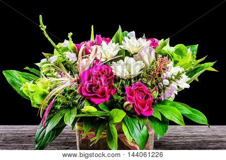 wedding bouquet with roses and white gerberas on an old wooden table view from above close-up