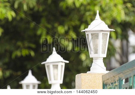 Lamp Pole and Fence Shrine with Natural background