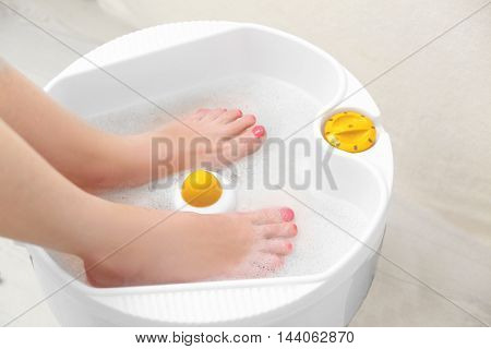 Woman getting a pedicure  in a beauty salon, close up