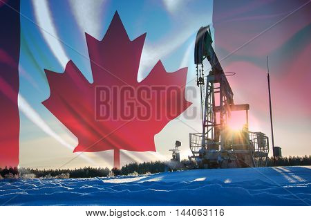 Oil pumps. Oil rocking chair. Oil industry equipment. Oil rocking chair closeup. Oil rocking chair on a background of blue sky. TCanada oil company Canada Flag Winter
