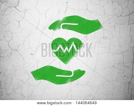 Insurance concept: Green Heart And Palm on textured concrete wall background