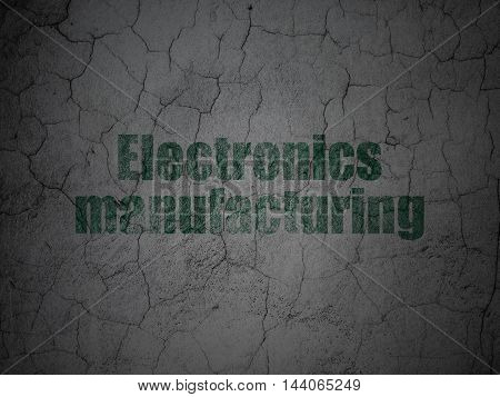 Industry concept: Green Electronics Manufacturing on grunge textured concrete wall background