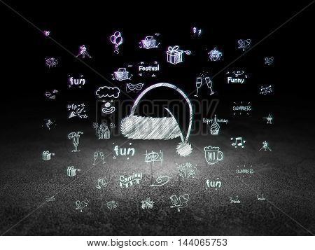 Holiday concept: Glowing Christmas Hat icon in grunge dark room with Dirty Floor, black background with  Hand Drawn Holiday Icons