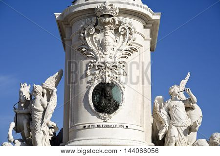 View of the front of the pedestal with King Jose coat of arms and a bronze medallion with the bust of Marquis of Pombal in Lisbon Portugal 12 of October of 1833