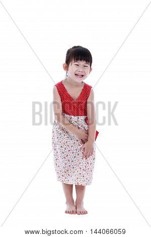 Full body of happy asian child standing in studio isolated on white background. Playful girl smiling and shying. Studio shot. Child tooth smile and a look of enjoyment on face. Positive human emotion