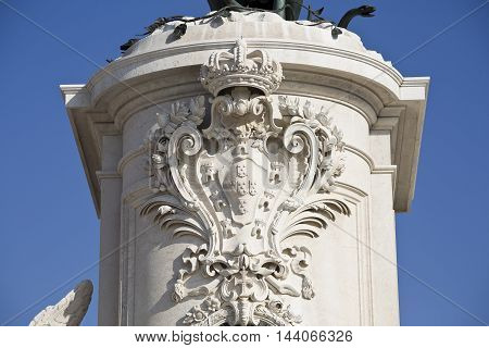 View of King Dom Jose coat of arms on the front of the pedestal of the equestrian statue in Commerce Square in Lisbon Portugal