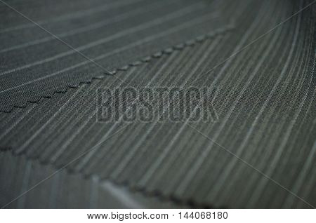 close up line black fabric of suit photo shoot by depth of field for object