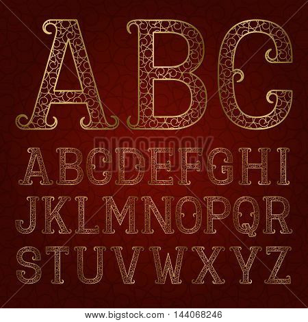 Golden ornamental letters with flourishes on red patterned background. Vintage decorative font. Isolated latin alphabet.