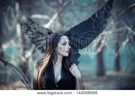 dark fairy in the woods. Blue tone picture