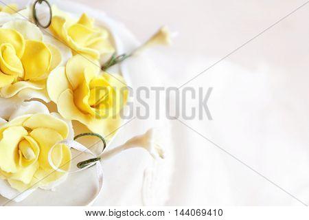 Beautiful wedding cake decorated with roses, closeup