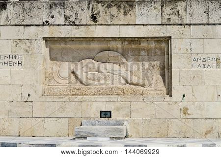 Athens, Greece. Tomb of The Unknown Soldier outside Greek Parliament. It depicts a dead soldier lying, with his shield on his left hand.